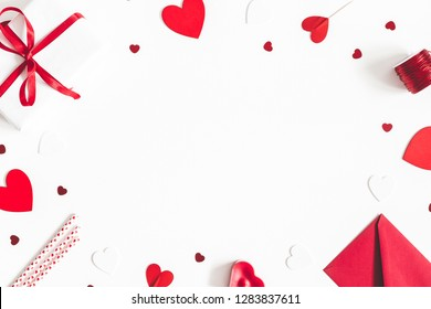 Valentine's Day background. Gifts, candle, confetti, envelope on white background. Valentines day concept. Flat lay, top view, copy space