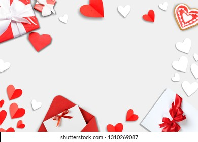 Valentine's Day background. Gifts, candle, confetti, envelope on pastel blue background. Valentines day concept. Flat lay, top view, copy space          - Image