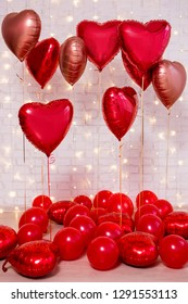 Valentine's day background - group of red balloons over white brick wall