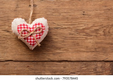 Valentines day background with handmaded hearts over wood