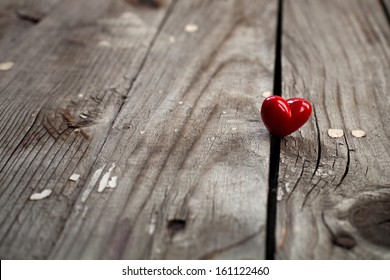 Valentines Day background with heart on wooden surface