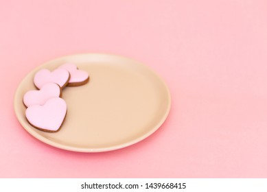 Valentines day background with heart shaped gingerbread cookie.