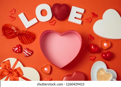 Valentine's day background with heart shapes, coffee cup and gift box. Top view from above