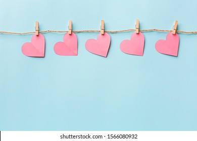 Valentine's day background with hearth on blue. Flat lay, top view, mockup, template, copy space. Minimal abstract composition for 14 February celebration