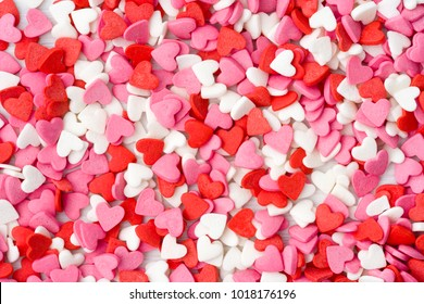 Valentines day background hearts, colorful candies