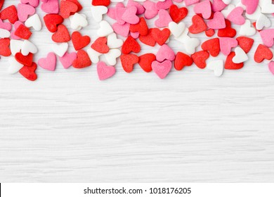 Valentines day background with hearts, colorful candies