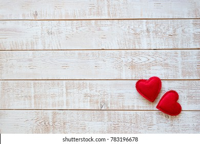 Valentines Day background with hearts over white wooden table - opy space