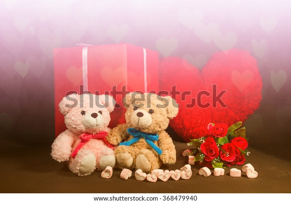 Valentines Day background with hearts, teddy bear, red roses, gift box. White and pink filter
