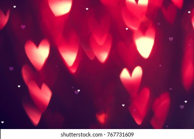 Valentine's Day Background. Holiday Blinking Abstract Valentine Background with Glowing Hearts. Heart Shape Bokeh. Love concept