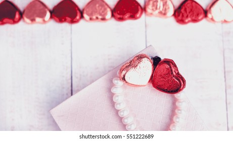 Valentine's day background, Love concept, two heart in pearl necklace on box, couple in love