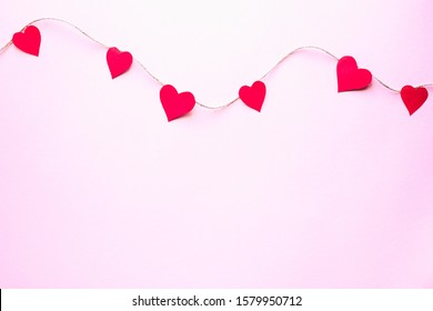 Valentine's Day background. Paper hearts over pink  background Valentine's Day concept Flat plan, top view.