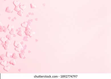 Valentine's Day background. Pink hearts on pastel pink background. Valentines day concept. Flat lay, top view, copy space