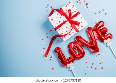 Valentine's day background - present, love baloon, confetti, top view