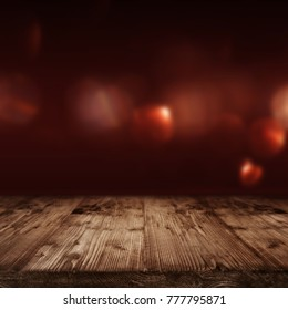 Valentines day background with red bokeh and empty wooden table for a decoration