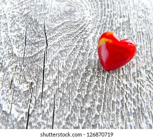 Valentines Day background. Red heart on wooden background