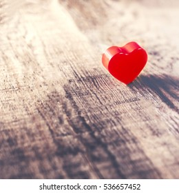 Valentines Day background with red heart on old wooden board  with copy space.  Holidays card.