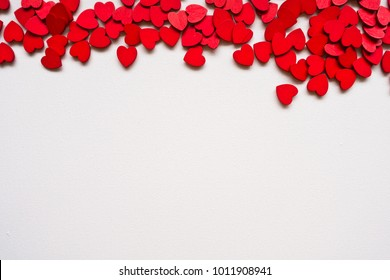 Valentines Day background with red hearts on white surface. Romantic seamless pattern for holiday, flat laz, top view