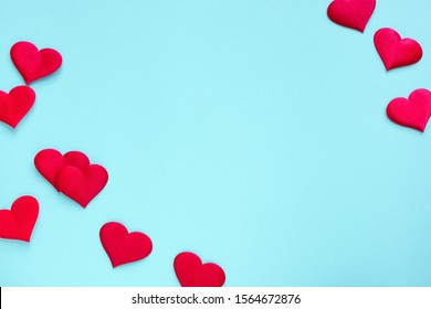 Valentine's Day background. Red hearts on pastel blue background, copy space. Valentines day, love, wedding concept. Flat lay, top view.