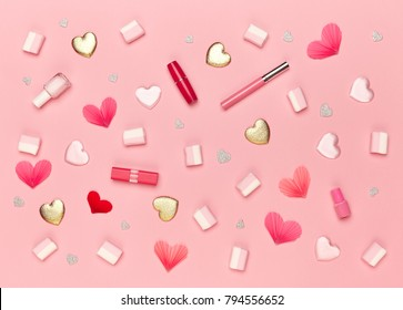 Valentine's Day Background. Red Hearts on a Pink background. Flat Lay. St.Valentine's Day Wallpaper. Women Accessories. Lipstick and nail Polish