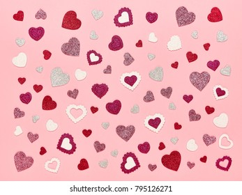 Valentine's Day Background. Red Hearts on a Pink background. Flat Lay. St.Valentine's Day Wallpaper. Love concept