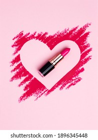 Valentine's Day background. Red and pink lipstick smeared in the shape of heart. Isolated on pink background. Cosmetic products
