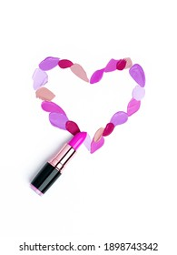 Valentine's Day background. Red and pink lipstick smeared in the shape of heart. Isolated on white background. Cosmetic products