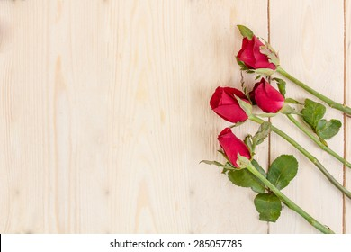 Valentines day background with red roses on wood texture for background.