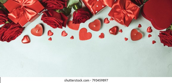 Valentine's day background with roses, gifts, hearts and candles.Valentines day concept. Top view. Copy space.