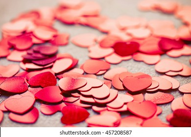 valentine's day background with shiny confetti heart shape, macro photo, selective focus
