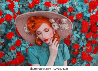 Valentines Day background. Spring bloom rose flower garden. Fabulous lady with red nails in dress. Trendy summer hat. Awesome flower wall. Redhead lady on background of rose garden. Stylish hat