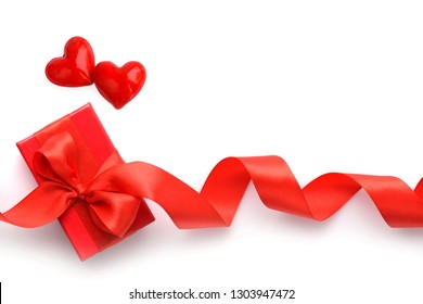 Valentines Day background. Two hearts and red gift box on white background