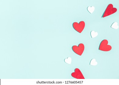 Valentine's Day background. White and red hearts on pastel blue background. Valentines day concept. Flat lay, top view, copy space