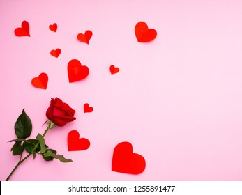 Valentine's day background,Red rose with have heart red paper on pink background,For card and wedding background
