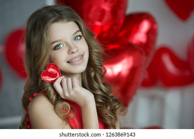 Valentine's Day. Beautiful girl red with heart.