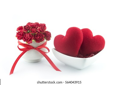 Valentine's day., A bouquet of roses in white glass and heart on beads in a white cup., Concept give a love.