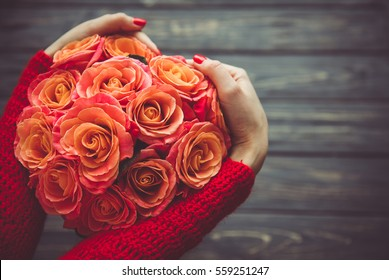 Valentine's Day bouquet of roses in woman hands.