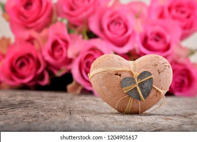 Valentines day, card with heart and pink roses. Holiday background. Flowers for mother.