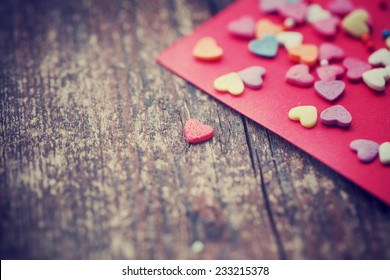 Valentine's day card with small hearts on wooden background/ romantic love background