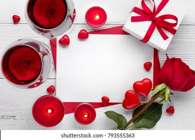 valentine's day celebration with red wine,burning candle and rose.