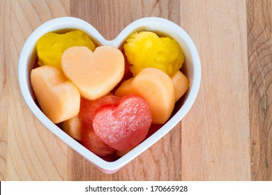 Valentines Day child friendly healthy treat with heart-shaped fruit cantaloupe, watermelon and pineapple