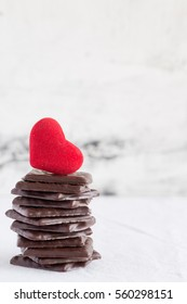 Valentines day chocolate sweets and red velvet heart on white background Copy space