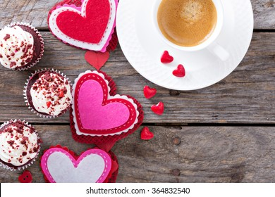 Valentines day coffee and cupcakes with decorations copy space