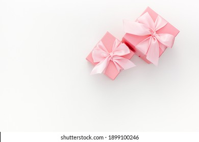 Valentines day composition: two pink gift boxes with ribbon