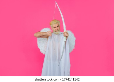 Valentines Day concept. Arrow of love. Cupid throws arrow with bow. Bearded angel with bow and arrow. Cupid angel with bow and arrows. Cupid in valentine day. Valentines cupid.