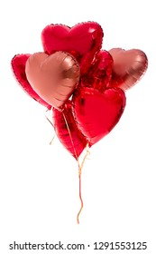 Valentine's day concept - bunch of red heart shaped balloons isolated on white background