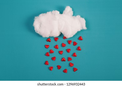Valentines day concept, cotton Ball Cloud Rain Hearts Red on Blue Sky Background.