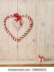 Valentine's day concept. Decor heart vines on a light wooden background.