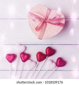 Valentines day concept with heart shaped gift box over light wooden background