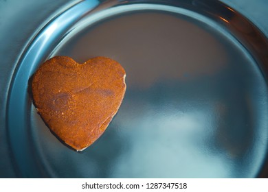 Valentine's day concept. Heart-shaped cookies on a black plate