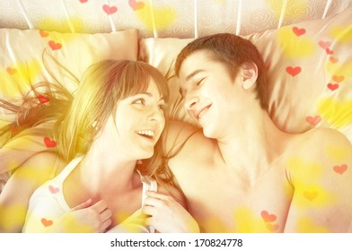 Valentine's day concept. Portrait of a happy young couple having fun on the bed